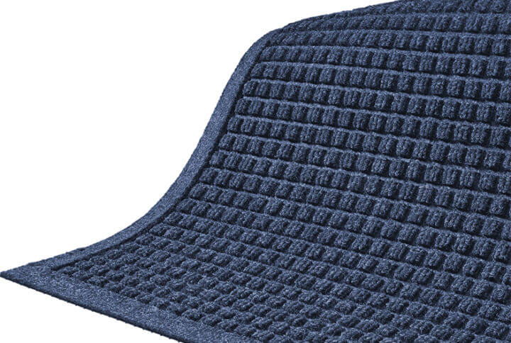 closeup of a waterhg mat with fashion border