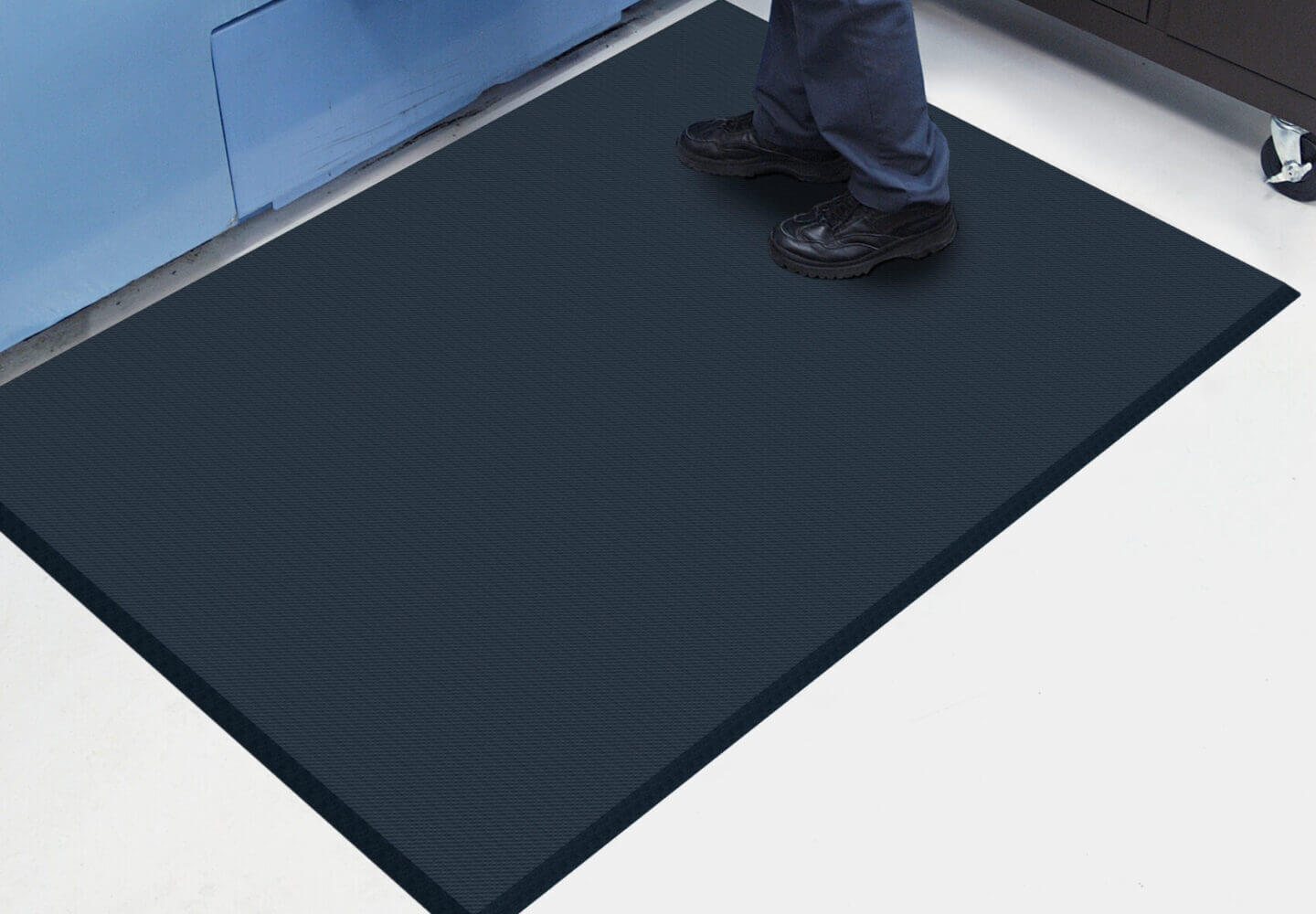 someone standing on an anti-fatique mat