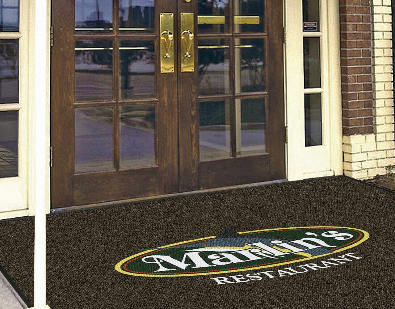 custom logo mat in the entrance of a restaurant