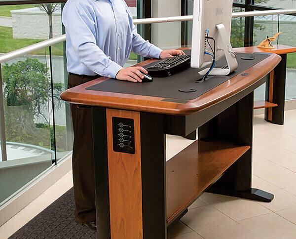 man at a standing desk with an anti-fatigue mat under his feet