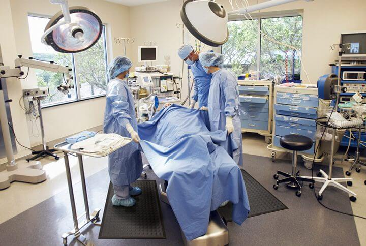 Surgeons preparing for surgery