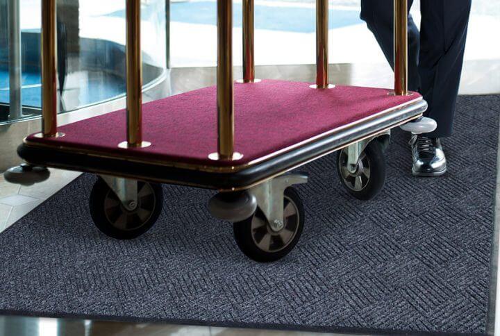 cart rolling over a waterhog mat