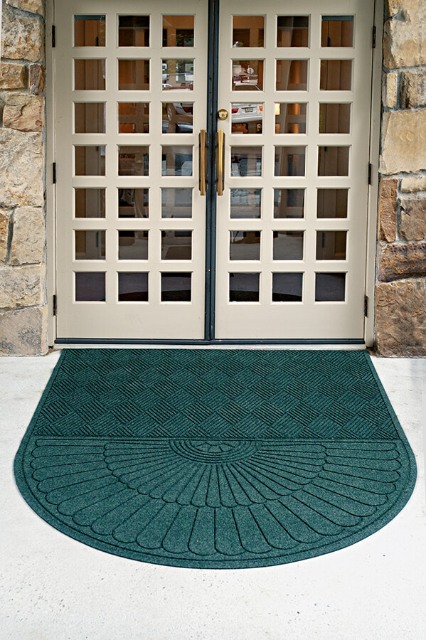 Waterhog Eco Grand Premier mat in front of a business's entryway