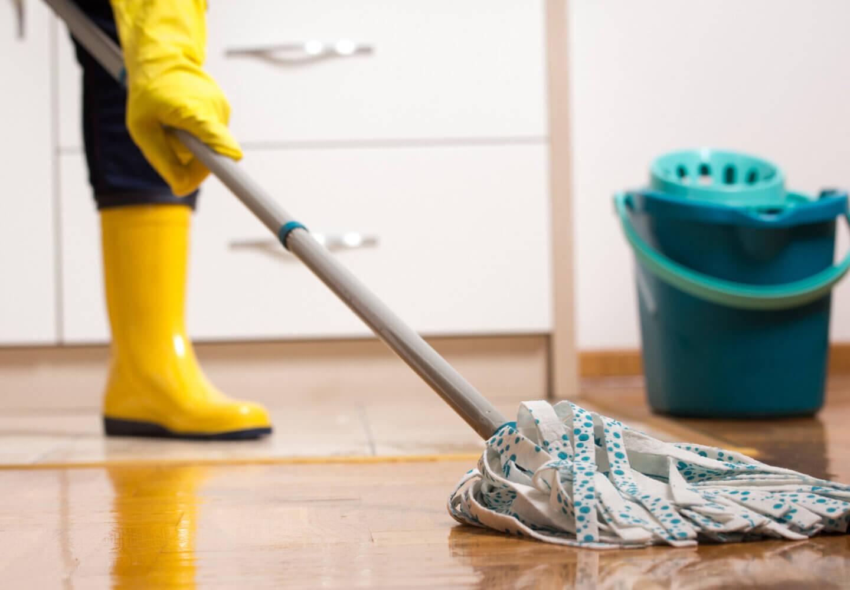 Housekeeper mopping tiled floor